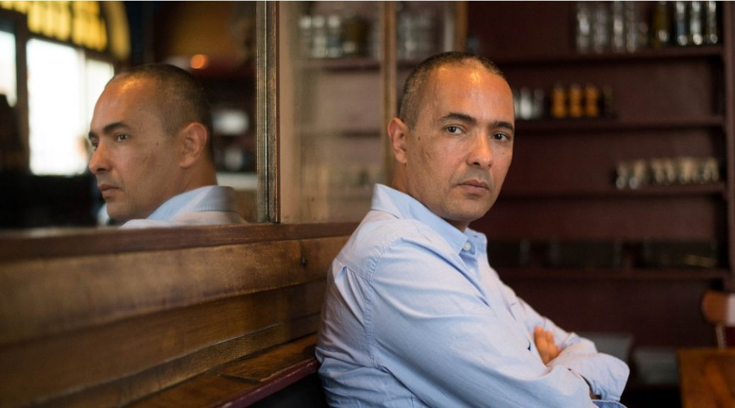 """Algerian writer and journalist Kamel Daoud poses as part of a meeting with a journalist in Marseille, southern France, on October 27, 2014. Daoud received the Francois Mauriac literary award for his book """"Meursault, contre-enquete"""" (Meursault, counter-investigation). AFP PHOTO / BERTRAND LANGLOIS"""